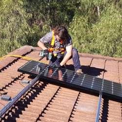 Jack installing solar panels